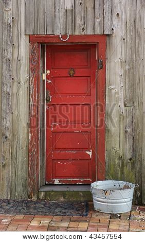 Red aged door way