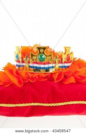 Golden crown on red velvet pillow for coronation in Holland