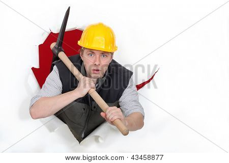 Worker bursting through with a pickaxe