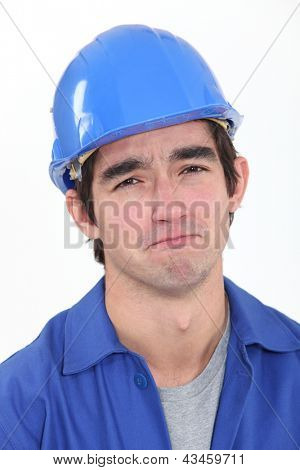 Glum construction worker