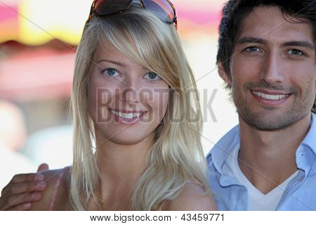 Attractive couple stood by market