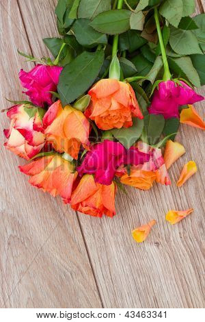 bouquet of roses with petals