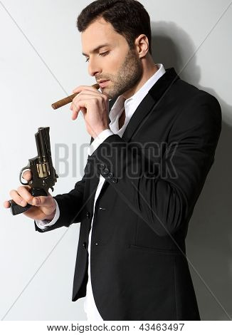 Man Holding a fire gun and smoking a cigar