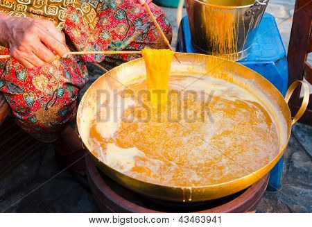 Hands Of Old Women Making Foi Thong (thai Dessert Made Mainly From Duck Egg Yolks And Sugar)