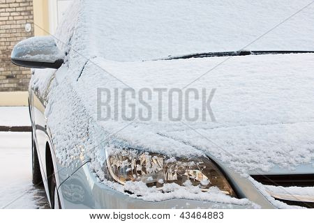 Car Covered In Fresh Snow
