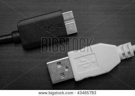 White USB and black USB SS on black background