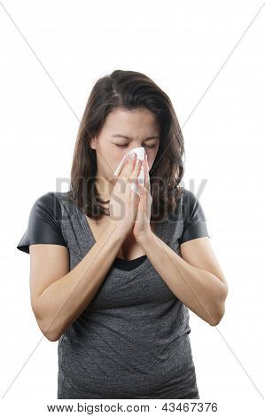 young woman blowing nose