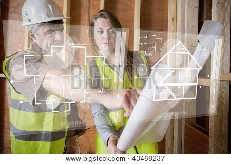 Architect and foreman looking at the plans on interface hologram in white