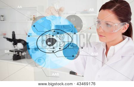 Chemist examining blue cell futuristic interface