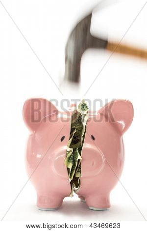 Hammer breaking piggy bank with money inside on white background