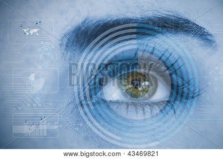 Close up of woman eye analyzing circuit board and chart interfaces in blue