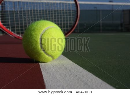 Tennis Ball With Red Racquet