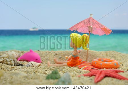 Girl Under The Sun Umbrella On The Beach