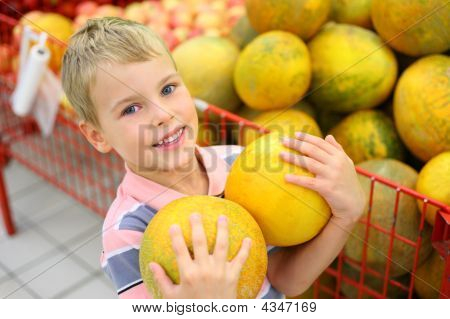Boy With Melons In Shop