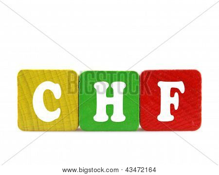 Swiss Franc - Isolated Text In Wooden Building Blocks