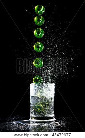 Ball Sequence Falling Into A Water Glash