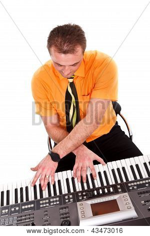 Boy Plays On Synthesizer