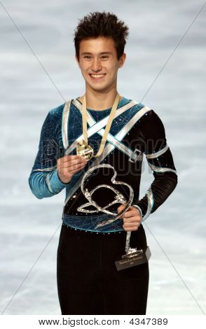 Canada's Figure Skater Patrick Chan Poses At The Medal Ceremony