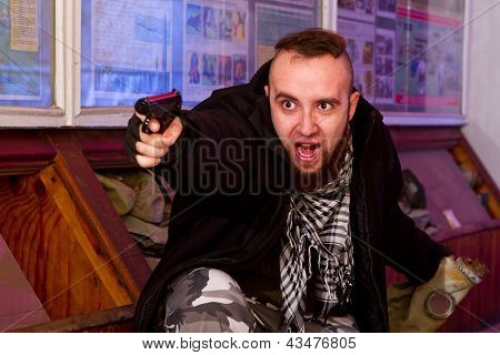 Bearded Terrorist With A Gun In The Stroma Of A Dilapidated Shelter