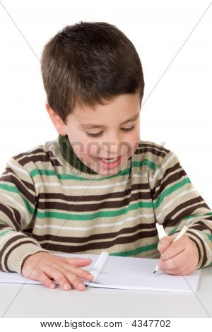 Adorable Child Writing In The School