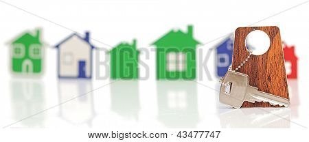 silver key with blank label over the houses background. Space for your text