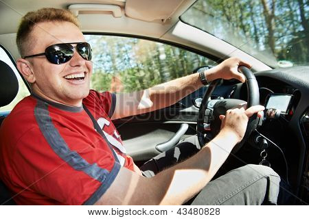 Happy laughing car driver man driving automobile  at summer