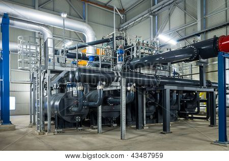 pumps and piping system inside of industrial plant