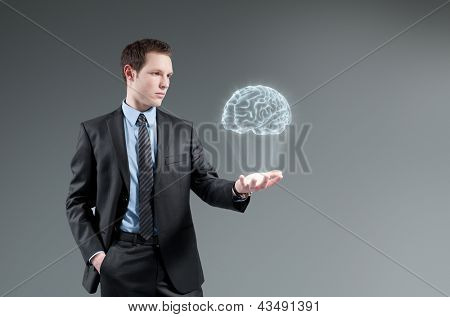 Man holding brain Hologram. Creativity idea concept.