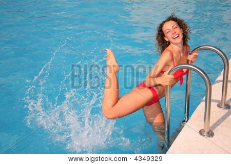 Young Woman Splashing In Basin