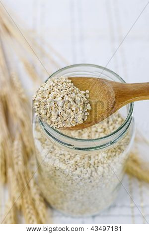 Raw Oats In Wooden Spoon