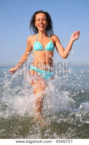 Young Woman Runs On Water In Sea