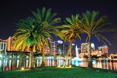 image of skyscrapers  - Orlando downtown skyline panorama over Lake Eola at night with urban skyscrapers - JPG