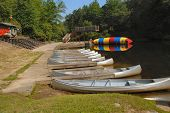 picture of bounce house  - Summer fun at the waterfront with canoes boating bouncing swimming and playing at camp