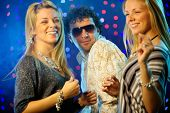 stock photo of night-club  - Happy friends dancing in the club  - JPG