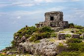 stock photo of mayan  - Mayan temple in the ancient city of Tulum in Mexico outside of Cancun - JPG