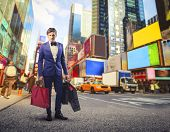 stock photo of going out business sale  - young guy with a lot of bags goes shopping in New York - JPG