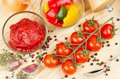 picture of homogeneous  - ingredients for making sauce from tomato and bell pepper vegetable and spice on cutting board - JPG