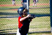 foto of little-league  - Little league baseball catcher waiting on the ball - JPG