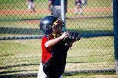foto of little-league  - Little league baseball catcher waiting on the ball - JPG