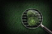 image of computer hacker  - Magnifying Glass searching code for online activity - JPG