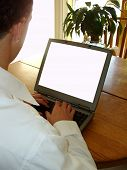 stock photo of computer-screen  - man working on laptop computer with a blank screen  - JPG