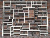 stock photo of shelving unit  - Illustration of empty shelving unit against a brick wall - JPG