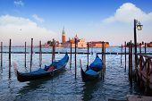 stock photo of gondola  - Gondolas and San Giorgio Maggiore church on Grand Canal in Venice - JPG