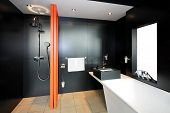 stock photo of lavabo  - Bathroom all in black with orange divider - JPG