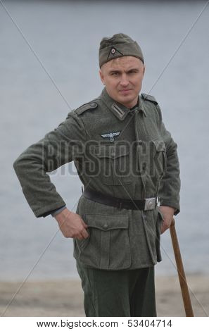 KIEV, UKRAINE -NOV 1: An unidentified member of Red Star history club wears historical German uniform during historical reenactment of WWII, Battle for Kiev 1943 on November 1, 2013 in Kiev, Ukraine