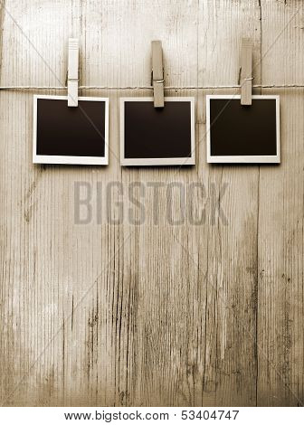 snapshots hanging from a rope