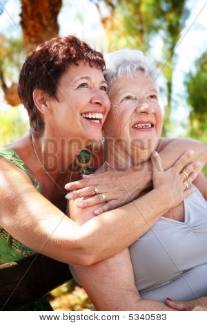 Beautiful Senior Mother And Daughter Smiling