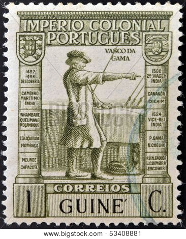 PORTUGAL - CIRCA 1932: A stamp printed in Portugal with underprint Guinea shows Vasco Da Gama
