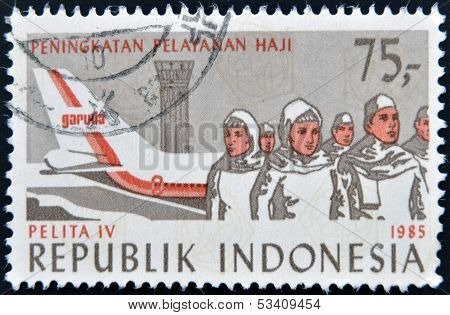 Stamp printed in Indonesia dedicated to Fourth Development Cabinet Pelita IV shows plane and people