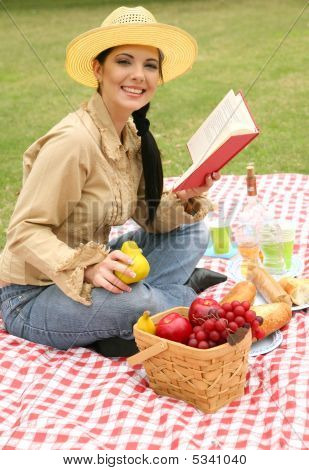 Smiling Woman Enjoying Summer Picnic